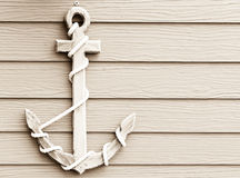 Wooden anchor on wall vintage background. Close up wooden anchor on wall vintage background stock image