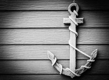 Wooden anchor on wall vintage background. Close up black and white wooden anchor on wall vintage background , vignette stock image