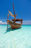 Wooden anchored dhow boat Stock Photo