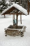 Wooden  ancient water well  in winter Royalty Free Stock Photo