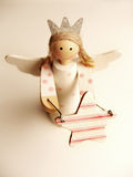 Wooden angel with a star. Wooden angel carrying a large striped star Royalty Free Stock Photos