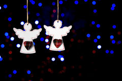 Wooden angels on a dark background Royalty Free Stock Image
