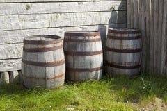 Wooden Antique Barrels. Three wooden antique barrels in a row Stock Images