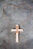 Wooden antique look crucifix necklace isolated Royalty Free Stock Images