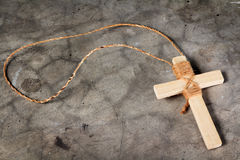 Wooden antique look crucifix necklace isolated Royalty Free Stock Photo