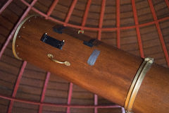Wooden antique telescope. This working 126 year-old Newtonian telescope has a 12.5 inch mirror, is 10 feet long and offers superb views of the night sky. It is Royalty Free Stock Image