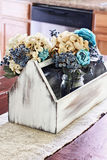 Wooden Antique Toolbox with Flowers on Farmhouse Table Royalty Free Stock Photos