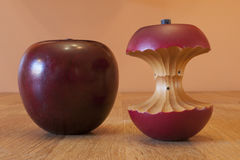 Wooden Apple and Core. Carved wooden apple and apple core on butcher block counter Stock Images