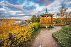 Wooden arbor on the Cathedral Hill. In the autumn Plyos and a view of the city from the height of the mountain behind the fence Royalty Free Stock Photo