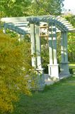 Wooden Arbor in a green park on sunny summer day . Landscaping. stock photos