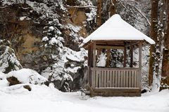 Wooden arbor near forest at resort. On winter day stock photography