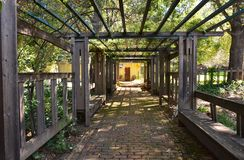 Wooden arbor. A wooden arbor outside a house royalty free stock images
