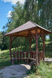 Wooden arbor in the park. Wooden arbor on the background of trees in the park Stock Photos