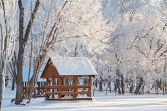 Wooden arbor in winter forest. Wooden arbor in winter snowy forest Royalty Free Stock Images