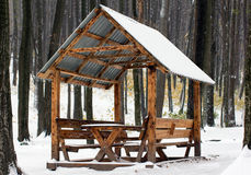 Wooden arbour covered with white snow in the forest. Wooden arbour covered with white snow in the autumn forest Stock Photo