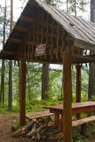 Wooden arbour for rest in field Royalty Free Stock Image
