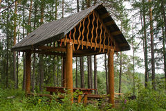 Wooden arbour for rest in field Royalty Free Stock Images