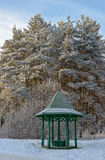 Wooden arbour in winter garden. Trees and wooden arbour covered with hoarfrost in winter garden Royalty Free Stock Photos