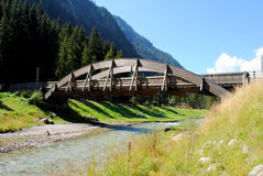 Wooden arc bridge in mountain landscape. Wooden bridge in mountain landscape Royalty Free Stock Photo