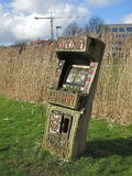Wooden arcade machine. Arcade machine carved out of wood, as an art object in a public park Royalty Free Stock Images