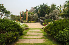 A wooden,arch bridge in a garden.  Royalty Free Stock Photography
