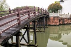 Wooden arch bridge-Nanchang Mei Lake Scenic Area. Nanchang Mei Lake scenic spot in detail, refined garden, curved Pavilion, platform and other types of gardens Royalty Free Stock Images