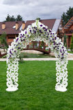 Wooden arch and chairs at wedding ceremony. Arch and wooden chairs at the wedding ceremony, green grass Royalty Free Stock Images