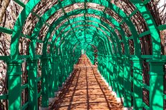 Wooden arch in the estate in perspective. 2018 Stock Photos