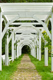 Wooden arch passage. White wooden arch passage in the park, Taujenai, Lithuania Stock Photo