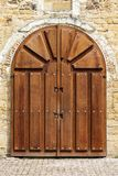 Wooden arch-shaped gate to an ancient church stock photography