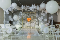 Wooden arch at wedding ceremony. Wooden arch and chairs at wedding ceremony Stock Images
