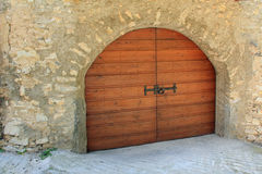 Wooden arched garage door Royalty Free Stock Photography