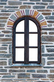 Wooden arched window in a stone wall Royalty Free Stock Image