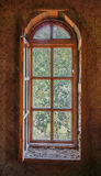 Wooden arched window. View to the garden through a wooden window Stock Images