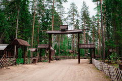 Wooden arches and fences at entry into the village. Royalty Free Stock Photography