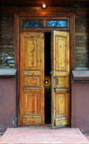 Wooden architechture of Siberia. Wooden and metal doors of Tomsk buildings Royalty Free Stock Photo