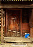 Wooden architechture of Siberia. Wooden and metal doors of Tomsk buildings Royalty Free Stock Photography