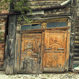 Wooden architechture of Siberia. Wooden and metal doors of Tomsk buildings Royalty Free Stock Image
