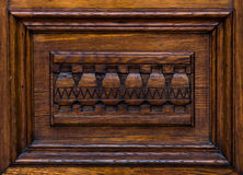 Wooden architectonic decoration. Architectonic decoration. This element made of wood is an inferior part of a door Royalty Free Stock Images