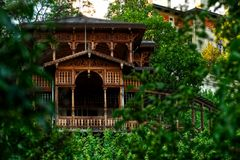Wooden architecture in a green park Royalty Free Stock Photography
