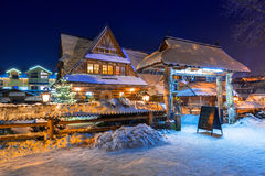 Wooden architecture of Zakopane at snowy night, Poland Royalty Free Stock Images