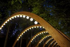 Wooden archway with decorative lighting. Royalty Free Stock Photography