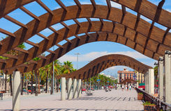 Wooden arcs on central quay of Barcelona. Royalty Free Stock Photo