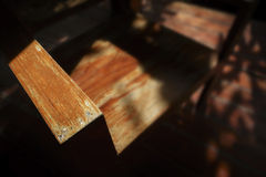 Wooden arm shair. Selective focus and close up : wood chair and sahdow of sunlight Stock Images