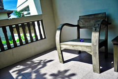 Wooden armchair on a balcony Stock Images