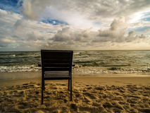 Wooden armchair at the beach Royalty Free Stock Photos