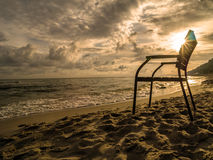 Wooden armchair at the beach Stock Image