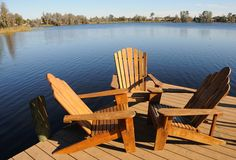 Wooden Armchairs by the Lake Royalty Free Stock Photography