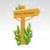 Wooden arrow with Christmas toys with text Stock Photo