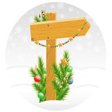 Wooden arrow decorated with Christmas toys Stock Images